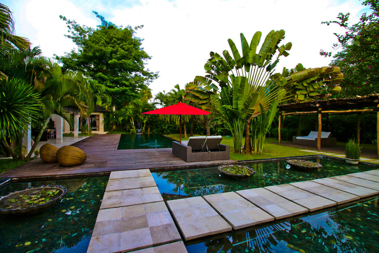 The villa with fish pond with clear water awaits you here