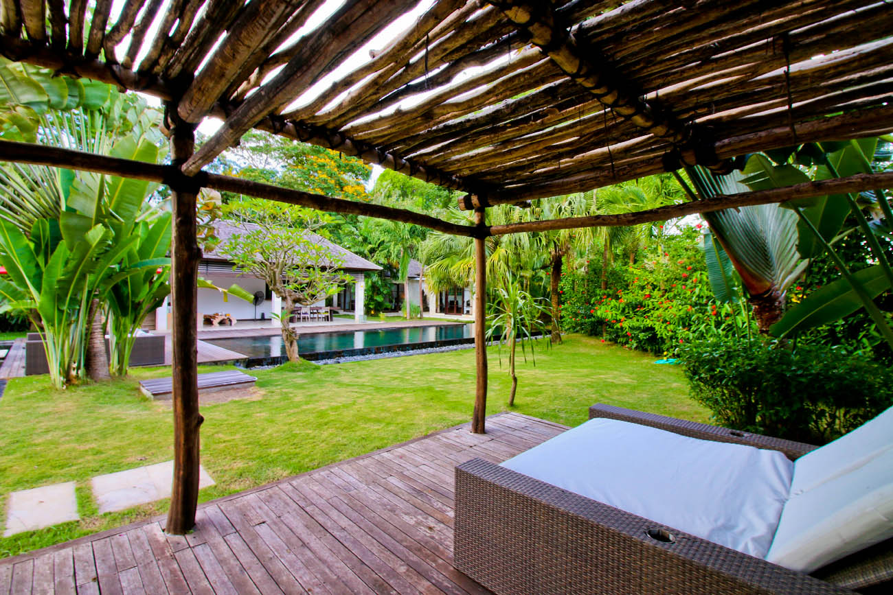 Sundeck at Villa Tom Canggui with rustic pergola